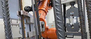 Automated tensile tests on concrete-reinforcing steel