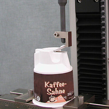 Activation force of coffee creamer container