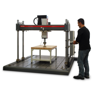 Portal testing machine with electromechanical testing actuator.