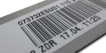 The bar code or 2D code is read during the automated sequence